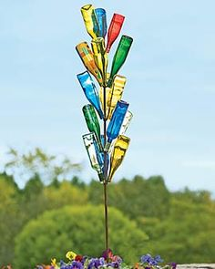 Bottle trees add such bright colors to a garden area