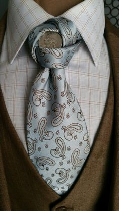 """The Penrose knot get the tie here <a href=""""http://www.thecorvancollection.com"""" rel=""""nofollow"""" target=""""_blank"""">www.thecorvancoll...</a>"""