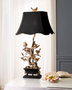 """Bird & Branch"" Table Lamp at Neiman Marcus. Black and gold table lamp has songbirds perched amid its leafy branches and one more on the finial.        Hand-cast resin base.      Cast metal leaves and birds.      Shade is dupioni silk.      Uses one 100-watt bulb.      16""W x 13""D x 32""T."