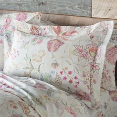 """FLOWER SKETCHES SHAMS -- Scattered with innocent abandon on fresh white cotton, fanciful flowers that might have come from an artist's sketchbook invite you to blissful sleep. Flanged shams with envelope backs are the perfect complement to our duvet cover. Machine wash. Imported. Standard, 28-1/2"""" x 22-1/2"""""""