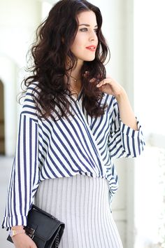 Malena from Fashion Container wearing a marine striped wrap shirt, a grey knit skirt, gorgeous beachy waves and red lipstick.