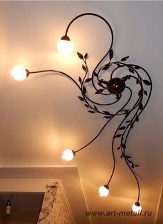 Wrought iron chandelier with floral ornaments Wrought Iron Chandeliers, Wrought Iron Doors, Floral Chandelier, Wood Chandelier, Lampe Art Deco, Fireplace Tool Set, Garden Lamps, Front Door Decor, Ceiling Lamp