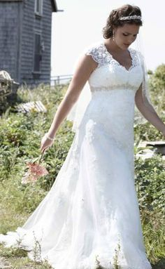 This empire, A-line plus size bridal gown is perfect for apple body shapes. The high waist will draw attention upwards away from your round middle and the A-line skirt will drape nicely over your middle and hips.  Repin Now!