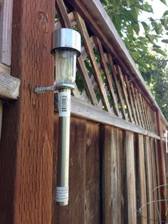Solar Pathway Lights on the fence. Easy and cheap to do. DIY, $2 for the light and $0.49 for eye bolt.