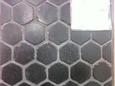 "Rustic patina black hexagonal tile.  This is a 2"" tumbled charcoal gray travertine.  Once sealed, it is a deep jet black."
