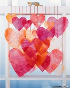 super easy: shave some pink and red-hued crayons onto wax paper. Top with another layer of wax paper and iron to melt into cool images. Cut into heart shapes and hang with string. Kids love it, and you probably have the necessary materials on hand.