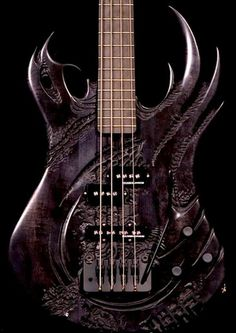 Powerful design for smoke black BASS guitar! Dark wood stained like walnut, staggered sparkling silver - black pickups plus whammy bar for great screaming rock sound. DdO:) MOST POPULAR RE-PINS - http://www.pinterest.com/DianaDeeOsborne/instruments-for-joy - Stringed INSTRUMENTS FOR JOY Pin photo via http://www.pinterest.com/claxtonw/4-5-6-strings/ Claxton Wilson's bass violin guitar piano harp Pinterest board 4 5 6 STRINGS.