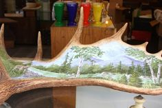 Painted shed horn. Deer and moose shed their horns naturally, so you don't have to hurt them to get them. How beautiful is the artwork? Painted Shed, Painted Antlers, Deer Mounts, Antler Art, Taxidermy, How Beautiful, Horns, Moose, Plate