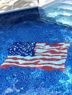 Make it a star-spangled summer. And add a touch of patriotic pride to your outdoor space with this splashy pool mat.