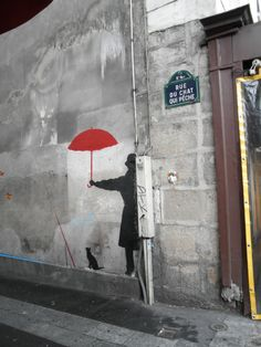 """Le Chat Qui Pêche"" the most narrow street in Paris. The name of the street ""The cat catching fish"" comes from a city legend that in 15th century there was an alchemist that walked on this street and he was always followed by a black cat. The cat was super smart and could catch fish in the Seine within a second. #parislegend #citylegend #streetsinparis"