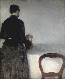 Vilhelm Hammershoï; En unge pige, som hoelder af en kande (Young Girl Pouring Tea - the Artist's Sister)