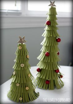 DIY Paper Christmas Trees.  I love this idea for our class party...but using paper towel tubes instead.  Cut a slit almost all the way to the bottom of the tube and roll it into itself so it tapers and tape or staple closed!! Way cheaper!