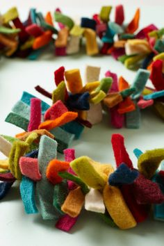Felted Bows Garland - anthropologie.com #thanksgiving #decorations #garland...  I could totally make this.  God, what they charge for things.
