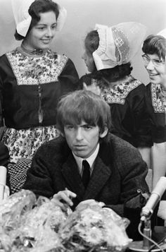 George Harrison at the Beatles' press conference at Schiphol airport, the Netherlands, 5 June 1964. Photo by Harry Pot.