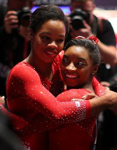 GLASGOW, Scotland (AP) — Simone Biles' third straight world title came by the biggest margin yet, points over teammate, buddy and reigning Olympic champion Gabby Douglas and bronze medalist Larisa Iordache of Romania. Gymnastics World, Sport Gymnastics, Olympic Gymnastics, Gymnastics Quotes, Gymnastics Posters, Artistic Gymnastics, Olympic Games Sports, Olympic Team, Usa Olympics