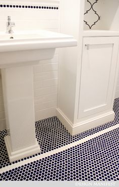 Love the navy blue penny tiles in this bathroom....