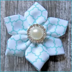 Gather your crafting supplies and join us for some fun on the blog! How to make a Petals Ribbon Flower