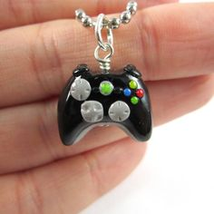 Xbox 360 video game controller necklace by TrenoNights on Etsy, $15.00 I so need one of those