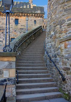 photo by Tom Gomez This curved stairway of 70 steps leading from the lower castle near the Portcullis Gate to the Upper Ward of Edinburgh Castle, Scotland. The curved wall a short way up on the right may have been part of a tower from the medieval castle. Edinburgh Travel, Edinburgh Castle, Edinburgh Scotland, Scotland Travel, Castle Scotland, Scottish Castles, England And Scotland, Stairway To Heaven, Medieval Castle