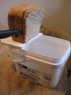 My bread bucket doubles as a cutting board AND crumb catcher Five Gallon Bucket, 5 Gallon Buckets, Invention And Innovation, Bread Boxes, Cutting Board, Frozen, Organising, Organizing Ideas