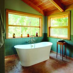 Oh, the windows... As lovely (very lovely) as this bathroom is, I think I'd be bothered by the lack of a real shower.  With a euro one like they have I would make a huge mess.
