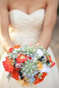 Vibrant poppies and succulents bouquet.