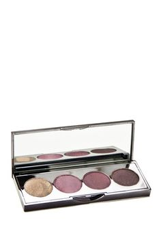 """Eyeshadow Palette - Luminizing by Lotus Cosmetics  Pressed mineral eye shadows make it easy to go from subtle to dramatic shades that last all day. - Size: 0.28 oz. - Color combination: Luminizing - Highly pigmented for long lasting wear - Each eye shadow quad consists of complimentary colors that can be blended together or worn individually - For directions and ingredients, see """"More Info"""" - Made in USA  Colors included:  - Ivory - Shimmery raspberry - Deep magenta - Shimmery purple plum…"""