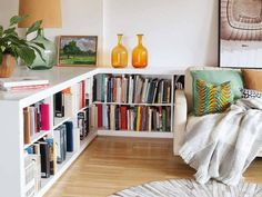 low bookcase surrounding living space, to define area