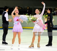 Akiko Suzuki (L) and Miki Ando, both announced retirement from the competitions, wave to fans during the Nagoya Figure Skating Festival at Nippon Gaishi Arena on April 3, 2014 in Nagoya, Aichi, Japan.