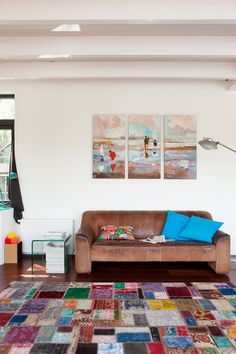 I do like the combination off the patchwork carpet and the vintage sofa. And I am proud off the beatifull painting of Jaap Broersma.  jkf.nl