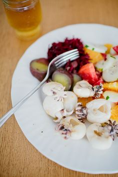 Ginger squids with sweet potatoes and tomato salad
