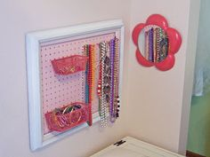I soooo need to make this for my daughter.  She has more (plastic) jewelry than I do!