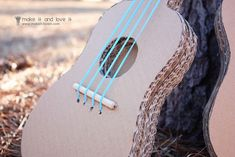 My husband plays the guitar, banjo and violin, and any time he picks up one of his instruments, the kids always seem to want to play along. Cardboard Guitar, Cardboard Crafts, Cardboard Play, Diy For Kids, Crafts For Kids, Diy Crafts, Banjo, Violin, Ukulele