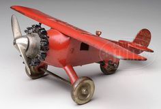 RARE RED HUBLEY LINDY CAST IRON AIRPLANE WITH GEARED REAR WHEEL.