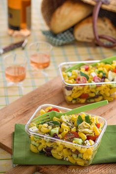 Greek pasta salad with corn-quinoa pasta, tomatoes, Kalamata olives, feta, herbs and artichoke hearts with a lemony vinaigrette