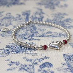 A personal favorite from my Etsy shop https://www.etsy.com/ca/listing/179361725/shop-bracelet-sale-sterling-silver-ruby