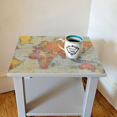 DIY IKEA Hack map table Upcycle an Ikea side table with a world map for a stylish piece of furniture.