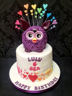 Furby cake.... they're kind of creepy... but I, myself own one. xDD