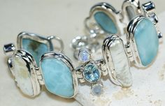 Larimar  , Blue Topaz bracelet designed and created by Sizzling Silver. Please visit  www.sizzlingsilver.com. Product code: BR-8493