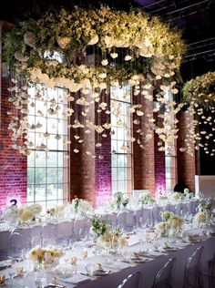 Hanging flower strands above wedding dinner tables