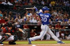 Josh Donaldson #20 of the Toronto Blue Jays hits a two run home run against the Arizona Diamondbacks during the first inning of the interleague MLB game at Chase Field on August 20, 2016 in Phoenix, Arizona.