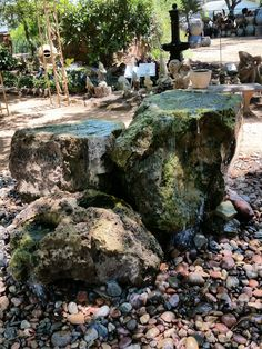 another view of the three handcarved lava rocks made into fountains