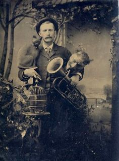 one man band, ca. 1880....What in the hell is that demon spawn under his arm??!?!  NO!  Go AWAY!