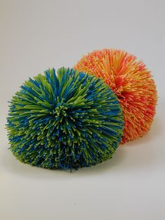 "Koosh!!   These were the best balls for games of ""monkey in the middle"" when we were in my grandmother's swimming pool."