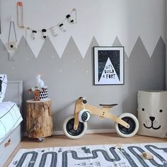 Love this cute kid's room! Wishbone bike and OYOY Adventure rug available online.