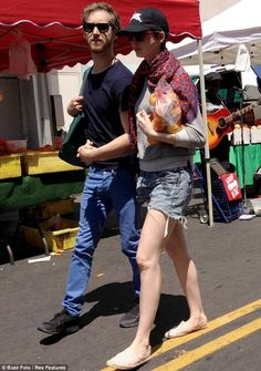 Happy couple: Anne Hathaway and fiance Adam Shulman