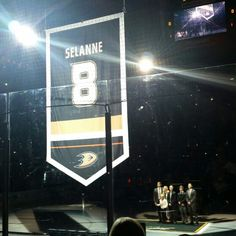 Teemu and family watch as Banner is raised #For8verTeemu