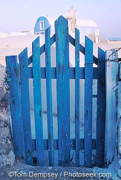 A blue gate in Oia, Santorini Island, GREECE