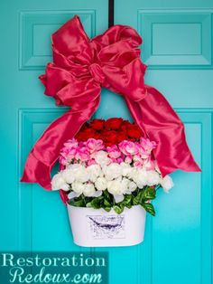 How I used Dollar Tree supplies to make a 3-Tiered Flower Wreath perfect for Valentine's Day.