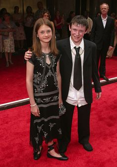 Maybe it's because she had to pose with her sweaty co-star, Devon Murray (aka Seamus Finnigan)?
